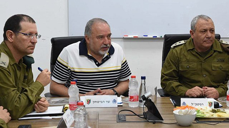 Avigdor Lieberman with security officials