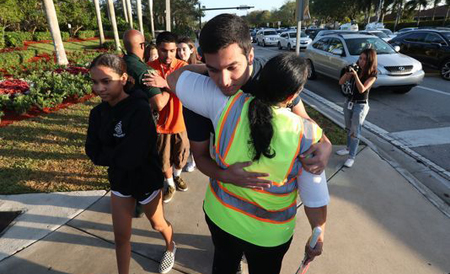 A student is comforted on the way into school